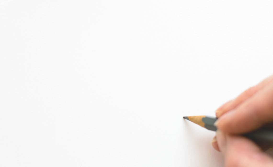 close-up-of-hand-holding-pencil-over-white-background-316466 (1)